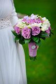 foto of bridal veil  - Bridal bouquet of purple roses in bride - JPG