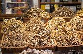 stock photo of magical-mushroom  - Dried mushrooms in a market - JPG