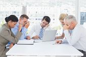 pic of concentration  - Concentrated business team working together in the office - JPG