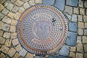 picture of paved road  - Hatch of sewage on the paving road in Tabor Czech Republic - JPG