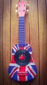 picture of heart sounds  - A ukulele decorated with a union jack with a vinyl record and a love heart - JPG