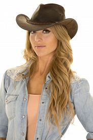 picture of cowgirl  - A cowgirl in her western hat with a playful expression - JPG