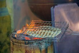 image of south east asia  - Indian flat bread roasted in the street of Georgetown Penang Malaysia. Penang is a well known street food capital of South East Asia.