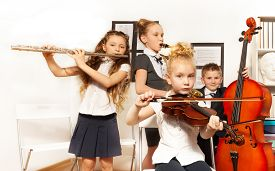 pic of classic art  - School children playing musical instruments together during their concert in school - JPG