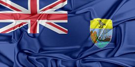 stock photo of ascension  - Flag of Saint Helena Ascension and Tristan da Cunha waving in the wind - JPG