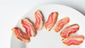 image of jerks  - jerked sliced bacon on a white plate - JPG
