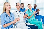 Doctors Listening To Lecture poster