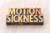 motion sickness  - word abstract in vintage letterpress wood type printing blocks poster