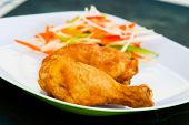 picture of fried chicken  - Fried chicken served with grated vegetables. Shallow DOF.