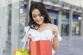Asian Women And Beautiful Girl Is Holding Shopping Bags Smiling While Doing Shopping In The Supermar poster