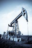 stock photo of nonrenewable  - Industrial oil pump jack  - JPG