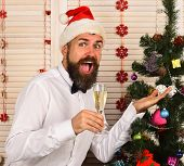Guy Near Christmas Tree On Wooden Wall Background. poster