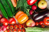 Fresh Vegetables On A Wooden Background poster