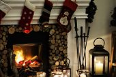 Christmas stockings hanging by the chimney poster