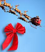 foto of santa-claus  - Christmas Santa Claus and red ribbon blue sky - JPG