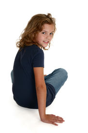 image of ten years old  - Beautiful nine year old caucasian girl sitting on white floor - JPG