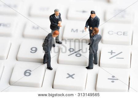 poster of Business Mans Standing On Calculator. Interest Rate Financial And Mortgage Rates. Compound Interest