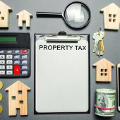 Table With Wooden Houses, Calculator, Coins, Magnifying Glass With The Word Property Tax. Property T poster