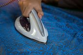 Mens Hands Holding Steam Iron poster
