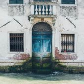 Venice Grand Canal (canal Grande). Beautiful Ancient Architecture. Windows And Blue  Door On White W poster