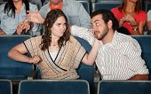 pic of pervert  - Irked woman gestures to punch man in theater - JPG