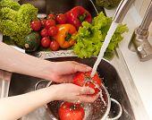 foto of mixing faucet  - Fresh vegetables splashing in water before cooking - JPG