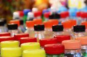 Multi-colored Plastic Bottle Caps, Close-up. Plastic Bottle Caps Varicolored, Selective Focus poster