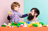 Child Development. Father And Son Play Game. Happy Family. Leisure Time. Little Boy With Bearded Man poster