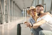 Vacation Selfie. Loving Couple Making Photo, Waiting For Boarding In Airport, Copy Space poster