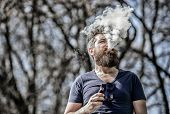 White Clouds Of Flavored Smoke. Smoking Electronic Cigarette. Man Long Beard Relaxed With Smoking Ha poster