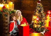 Mom And Kid Play Together Christmas Eve. Family Holiday. Happy Family. My Dear Baby Santa. Mother An poster