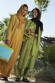 picture of dupatta  - Low angle view of two female friends standing together with shopping bags - JPG