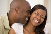 pic of love couple  - Close up of a Couples sat on a sofa together smiling - JPG