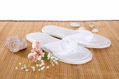 stock photo of spank  - Spa or hotel flip flops on a bamboo mat - JPG