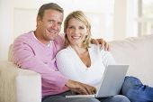 stock photo of portrait middle-aged man  - Woman using laptop in home office - JPG