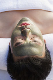 picture of mud pack  - Man wearing mud facial mask at health spa - JPG