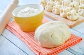 stock photo of bakeshop  - fresh dough on napkin and on a table