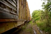 foto of boxcar  - A long line of boxcars on a train track - JPG