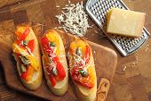 picture of collate  - Crostini small toasts with colored peppers and spices - JPG