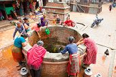 KATHMANDU,NEPAL-MAY 20: Nepalis drinking water extracted from wells on May 20, 2013, Lalitpur city,
