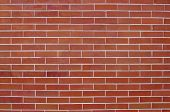 stock photo of grout  - The photograph shows a wall made of red bricks - JPG