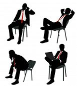 businessman sitting on the chair silhouettes