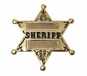 gold sheriff's badge on white
