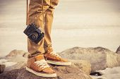 pic of shoe  - Feet man and vintage retro photo camera outdoor Travel Lifestyle vacations concept