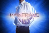 image of mainframe  - Businessman presenting the word mainframe against background with shiny ball - JPG