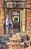 Beautiful young couple at door of Prasat Pre Roup temple in Angkor wat complex, near Siem Reap, Camb