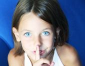 pic of shhh  - a caucasian child with her forefinger to her mouth saying shhh to be quiet - JPG