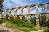 foto of aqueduct  - Beautiful view of roman Aqueduct Pont del Diable in Tarragona - JPG
