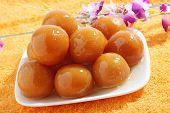 foto of jamun  - sweet balls called gulab jamun an indian sweet in a dish - JPG