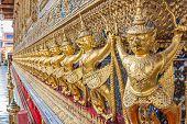 stock photo of garuda  - Guardian Garuda support the base of Wat Phra Kaew Temple of Emerald Buddha in Grand Palace the iconic landmark in Bangkok Thailand  - JPG